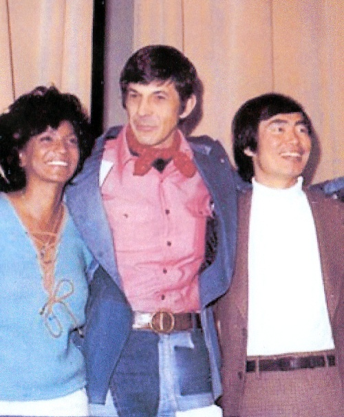 With Nichelle and George at a 1974 Convention. The ascot king strikes again -- this time in a fashion forward (for the time) incredible denim patchwork suit! I remember he wore this on his Mike Douglas show appearance, sorry I don't have full length shot of it! Love Nichelle's sweater here too.