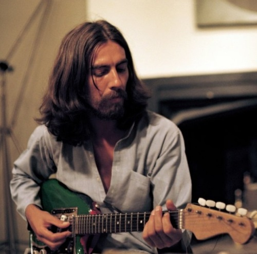 George Harrison with green guitar Living in the Material World