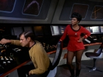 Uhura can't believe what a bad commander Hansen is; she takes over the bridge.